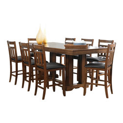 Homelegance - Homelegance Kirtland 9-Piece Counter Dining Room Set in Warm Oak - For your casual dining space, the Kirtland collection provides ample seating for your family and friends. Bench seating features button-tufted dark brown bi-cast vinyl. The horizontal and vertical slat supports form each chair back. The entire collection is highlighted by the Warm oak finish on oak veneers. The routed design on the table top carries over to the matching server. Counter height table options include classic leg table and oversize pillar-legged table. Also available in traditional dining height.