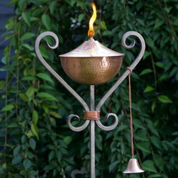 Brilliance Copper Tiki Torch - The best lighting for all occasion. Made in the USA of durable hand-forged iron, conveniently comes apart for easy shipping, assembly and storage.