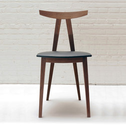 Dining Chair No. 6 - Pictured in walnut. Dining Chair No. 6 is the result of a growing understanding of reoccurring pitfalls found in dining chairs. The joinery in Dining Chair No. 6 by Reed Hansuld is all time honoured traditional mechanical joinery. Be it the pegged bridle joints or the sliding dovetails that attach the crest rail to the back legs this chair is constructed in a way that makes it next to impossible to break.