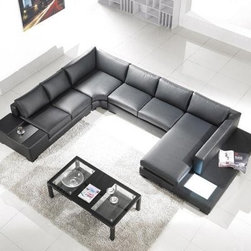 Tosh Furniture Modern Leather Sectional Sofa with Built-in Light - If your parties tend to turn into gripping think tank discussions, offer your guests complete comfort and convenience with the Tosh Furniture Modern Leather Sectional Sofa with Built-in Light. This amazing sectional unit uses luxurious top-grain leather wrapped around high-density foam for ultimate comfort; but the clean lines still maintain a modern look that compliments any contemporary decor. As a complete conversation set, this unit caps each end with a built-in end table. On one side, the solid hardwood tea table provides an extra surface for conversers to set drinks or plates. And at the other end, a long low sofa table with built-in lamplight allows you a shelf to display items or books, illuminating the discussion or simply setting a decorative tone for the room. With two sofa sectionals, a corner piece, and a chaise lounge, this sectional offers ample seating for seven people. And because it's constructed with a hardwood frame, it doesn't sacrifice durability for style.About Tosh FurnitureTosh Furniture has spent the last 20 years giving their customers the latest home furnishing styles while understanding that everyone is committed to a budget. Styles change fast, and Tosh Furniture has buyers worldwide that help provide looks from authentic vintage to futuristic, luxury or aggressively modern. Committed to value and craftsmanship in every piece they sell, Tosh Furniture is going to keep circling the globe to bring the best and latest to the marketplace.