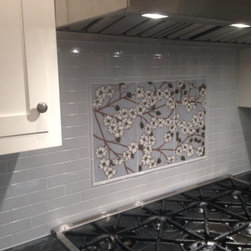 Commissions - Marina is a talented tile artist who did a lovely job on a custom backsplash for our kitchen. We could not be happier with the final result. She immediately understood what we wanted and worked closely with us to make sure that we were happy at each stage of the process, from the concept to the design to the final panels. Even though we are in another state, Marina was very responsive and we felt comfortable working with her via email and phone. She sent us a glaze color sample by mail so that we could select the surrounding field tile to match, and emailed us photos at each step of the process so that we could discuss the piece. The resulting panels are a beautiful, one-of-a-kind artwork that we will enjoy for years to come.
