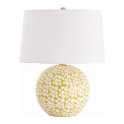 Arteriors - Zoey Lamp - This spherical lamp base hits the spot. Its mod dot design is created by applying wax to the porcelain, then glazing and firing it. While in the kiln, the wax melts to reveal the porcelain clay dots. Topped with a white microfiber shade, the lamp's pleasing shape and color instantly brighten a room.