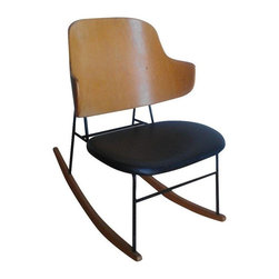 Pre-owned I. Kofod-Larsen Mid-Century Modern Rocking Chair - A scarce Mid-Century modern rocking chair designed by I. Kofod-Larsen. The shell and rocker rails were professionally refinished to their original color. The iron was left intact and is in great condition. There are some very tiny white paint dots on the black vinyl seat, but overall this chair is a real eye catcher!