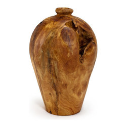 Bambeco Artisan Root Vase Medium - Each of our carved root vases is uniquely beautiful and stands alone as a work of natural art. For thousands of years, expert carvers have transformed gnarled stumps of fir trees into exquisite works of art such as this gorgeous vase. These stumps are left by logging operations and their removal allows faster re-growth of newly planted seedlings.Each one-of-a-kind vase is finished with environmentally friendly lacquer that protects and magnifies the natural beauty of the wood; knot holes and natural cracks add a unique charm. Use to display dried flowers or reeds, or just as a stunning piece on its own. Not recommended for liquids given the natural fissures and knotholes that may allow leakage.Available sizes: Small, Medium and Large.Dimensions (approximate): Small 6dia.x10H, Medium 8dia.x12H, Large 9.5dia.x14H.Care: Treat occasionally with light wax or mineral oil to brighten the luster. Also available in Large and Small.