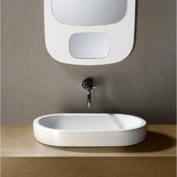 GSI - Oval-Shaped White Ceramic Vessel Bathroom Sink - Contemporary oval shaped white ceramic vessel bathroom sink. Washbasin comes with no overflow and no hole. Made in Italy by GSI. Vessel sink. Made out of white ceramic. No overflow. No Hole. Standard drain size of 1.25 inches.