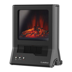 Lasko - Freestanding Fireplace Heater - Escape the cold with the Lasko CA20100 Ultra Ceramic Fireplace Heater. This portable, Space-Saving ceramic heater with an Easy-Grip handle offers the instant comfort and ambiance of a fireplace any place in the house. A Self-Regulating ceramic element plus a quiet blower system quickly circulates warmth throughout the room. When the room is warm enough, switch it to flame only to continue to enjoy the ambiance.1500-Watt ceramic heater offers the instant comfort and ambiance of a fireplace.