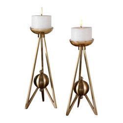 Uttermost Andar Coffe Bronze Candleholders S/2 - Plated coffee bronze metal with clear glass candle cups and cream candles. Plated, coffee bronze metal with clear glass candle cups and cream candles. Sizes: sm-6x15x6, lg-7x16x7
