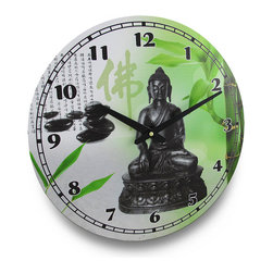 Meditating Buddha Enlightened One Round Wall Clock 15 in. - Resting on a stylized base, Buddha takes center stage on this pressed wood wall clock. His calm countenance and endless serenity are sure to remind you that its time for peace and relaxation! Enjoy the lush greenery and meditating stones of this clock's background in the kitchen, living room or in your meditation room. At 15 1/2 inches (39 cm) in diameter, it has bold, easy to read numbers and two large hands to easily tell the time, and the quartz movement requires 1 AA battery to run (not included). This clock would make a wonderful housewarming gift sure to be admired!