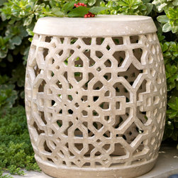 Horchow - Openwork Garden Seat - Of all of the places for a garden stool, the best is the garden of course! This one makes a beautiful statement against a backdrop of foliage.