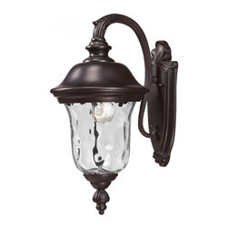 One Light Bronze Clear Waterglass Glass Wall Lantern - Traditional charm emanates from this small outdoor wall mount fixture, which pairs clear water glass with rubbed bronze hardware for a timeless look.