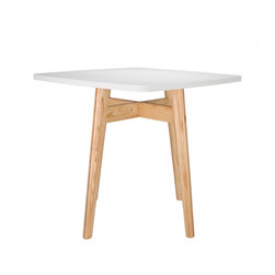 No Nonsense Table - This sleek table is all about simplicity. White and light wood merge here to create a piece that will open up your entire home. Just add a bouquet of bright flowers and some vibrant dinner plates to top it off.