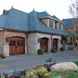 Carriage House Garage Doors - These wood stained garage doors by Carriage House  can be customized and installed by Automatic Door Specialists