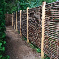 Hazelwood Hurdle Fence Panel - I like the basket weave of this fencing. It provides privacy and security with a more natural look than treated lumber.