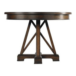 Stanley Modern Craftsman Red House Revival Table Saddle 955-61-38 - Enjoy your meals while sitting at the Stanley Modern Craftsman Red House Revival Table Saddle 955-61-38. The trestle legs, drop apron, and milled maple top give this table a distinctive craftsman style. The natural character of the hand-hewn wood is enhanced by the multi-step, individually rubbed finish in mink. Coming in at a diminutive 42-inches, this table is perfect for those that want a lot of style but don't have a lot of space.The Modern Craftsman CollectionEmbrace austerity with Stanley Furnitureís Modern Craftsman collection, a stellar combination of Mission style, Arts and Crafts detailing, and mid-century-modern influence. The collection celebrates hand-craftsmanship with exposed joinery and stretcher motifs, while the modern industrial hardware continues the dedication to subdued elegance. Crafted of veneers, this collection draws character from burnished corners, rub-through trimmings, and natural cow-tailing.Stanley Furniture Craftsmanship Stanley Furniture's main objective is to produce quality and stylish furniture by using the best wood materials, construction procedures, and elegant finishes on their products to help you fashion your home decor the way you imagined. All of their furniture is hand-crafted from quality woods, incorporating other superior materials such as aluminum, glass, plastic, leather, and marble. Every joint is carefully constructed (keeping wood's sensitivity to heat and humidity in mind) allowing for expansion and contraction. All joints are held together with glue and nail. Stanley's 30-step finishing process starts with an undertone stain that is applied to a hand-sanded piece. Next, the stain is sealed with a wash coat, then hand sanded again with filler applied to pack the wood pores and smooth out the surface. A sealer coat is then applied, the piece is hand sanded again, and hand padded to mellow the tone. From there, a luster glaze is rubbed on by hand, followed by antiquing or distressing also done by hand. Finally, after drying, each piece is hand waxed and rubbed prior to final inspection.About Stanley FurnitureSince 1924, the goal of the Stanley Furniture Company has been to manufacture high quality furniture at a price the average American family could afford. To accomplish this goal, founder Thomas Bahnson Stanley surrounded himself with the finest furniture craftsmen and instilled in them a sense of pride in building superb quality into every piece of Stanley Furniture. Today, that pride is shared by more than 1,750 dedicated associates who have made Stanley Furniture one of the largest, most respected furniture manufacturers in the nation.