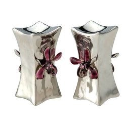 Kouboo - Salt & Pepper Shaker in Pewter - Cast from pewter, this hourglass-shaped salt and pepper shaker has been finished, polished and painted by hand. Because pewter does not tarnish like silver or copper, this salt and pepper shaker brings understated elegance to your table for a long time to come. 1 year limited warranty.