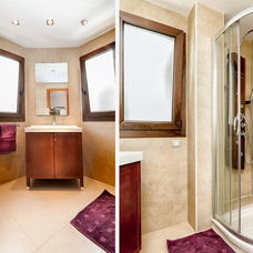 Transitional Bathroom by Goyo Photography