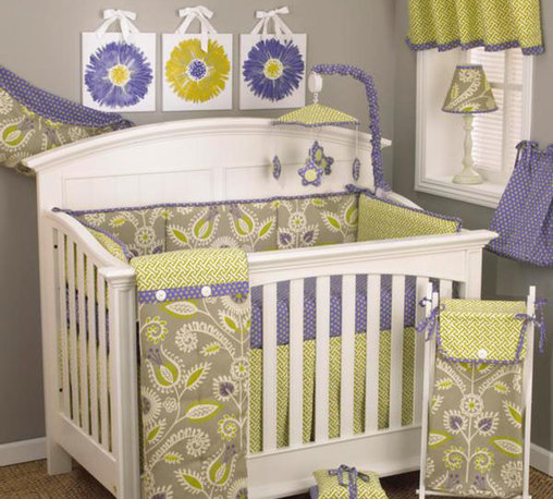 Cotton Tale Designs - Periwinkle 8 Pc Crib Bedding Set - A quality baby bedding set is essential in making your nursery warm and inviting. All Cotton Tale patterns are made using the finest quality materials and are uniquely designed to create an elegant and sophisticated nursery. The Periwinkle 8 piece set includes the 4 pc crib bedding(dust ruffle, fitted crib sheet, comforter, and bumper), diaper stacker, valance, toy bag, and pillow pack. The four sectional bumper is a combination of contemporary floral and lattice with periwinkle and green dot trim on cord ties. Sheet is in periwinkle with green dot. Dust ruffle is in green lattice. Comforter is a combination of all fabrics with a soft minky back. Perfect for the contemporary nursery and its looks wonderful with cribs of any color. The Periwinkle diaper stacker in periwinkle with green dot. Holds up to 4 dozen diapers. Fun and functional. Never tie on the crib. The Periwinkle valance is 100 % cotton lattice with periwinkle and green dot ties, measures 50 x 17. A versatile and perfect finish for the nursery windows. The Periwinkle toy bag is made in the contemporary floral and lined in the periwinkle dot. This toy bag is very versatile in that it can be used as wall decor or tied on changer to store supplies. The Periwinkle Pillow Pack consist of 3 decor pillows measuring in 10x10, 12x12, and 15x15 inches in size tied together in periwinkle dot ties. They can be used separately or tied together to make a fun accent for the nursery but should never be placed inside the crib. Makes for a perfect nursery for your baby girl. 100% cotton, wash gentle cycle, separately in cold water. Tumble dry low or hang dry.