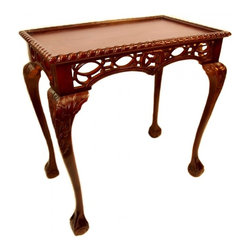 n/a - Gothic Chippendale Table - Our Gothic Chippendale table is solidly constructed carved mahogany with traditional ball and claw feet. Fine craftsmen apply many layers of lacquer finish to this table, for years of use. Notice the fine details in the Gothic style carving.  Steeped in the tradition of fine European manor homes, this carved table is a delightful addition to your collection for a great price! Measures 32 w x19.5 d  x 33 h. No assembly required.