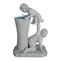 EttansPalace - Tall Refreshingly Girl and Boy Sculptural Fountain - Intrigued by the entrancing water music that cascades from the center spout into the basin, these young children echo the child in all of us as they help each other get a leg up for a quenching drink of water! This more-than-two-foot-tall, exclusive fountain is cast in quality designer resin with a faux stone finish and makes a refreshingly distinctive addition to home or garden as well as an heirloom investment in garden art. Includes UL-listed, indoor/outdoor pump. 19Wx12Dx28H. 23 lbs.