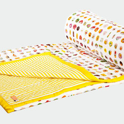 Yellow Mithai Quilt - Safomasi - Dream of colorful, sweet treats snuggled up with this cozy quilt from Safomasi. The irresistible mithai print is taken from the sketchbook of Safomasi founder, Sarah, who loves to sketch these fanciful Indian sweets during her travels in India. Printed and quilted by hand in New Delhi, the design requires a 13-color screen-print process, which is topped with a final layer of silver ink. The reversible quilt pairs the mithai print with classic yellow candy stripes.