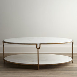 """""""Olivia"""" Marble-Top Coffee Table - The timeless design of this incredibly sophisticated oval coffee table adds soft balance to the angular lines of living areas. Two tiers of honed white marble provide ample display space."""