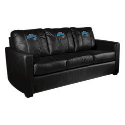 Dreamseat Inc. - Orlando Magic NBA Xcalibur Leather Sofa - Check out this incredible Sofa. It's the ultimate in modern styled home leather furniture, and it's one of the coolest things we've ever seen. This is unbelievably comfortable - once you're in it, you won't want to get up. Features a zip-in-zip-out logo panel embroidered with 70,000 stitches. Converts from a solid color to custom-logo furniture in seconds - perfect for a shared or multi-purpose room. Root for several teams? Simply swap the panels out when the seasons change. This is a true statement piece that is perfect for your Man Cave, Game Room, basement or garage.