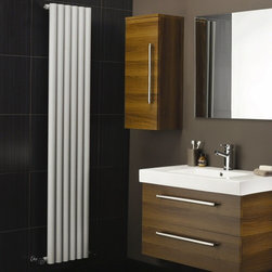 Hudson Reed - Savy White Vertical Designer Radiator 59 x 14 Circular Tubes & Valves - Six circular vertical tubes, finished in superior white powder coat (RAL9016), make this radiator a striking design feature of any contemporary living space. The large diameter tubes deliver an amazing heat output of 1047 Watts (3573 BTUs).Stylish and effective, this modern classic connects directly into your domestic central heating system by means of the radiator valves included. White Vertical Tube Designer Radiator 59 x 14 Features • Dimensions (H x W x D): 59 (1500mm) x 14 (354mm x 3.25 (83mm) • Output: 1047 Watts (3573 BTUs)• Maximum Projection from Wall: 5.25 (133mm)• Pipe centres with valves: 17.3 (440mm) • Number of columns: 6• Circular columns• Fixing Pack Included • Designed to be plumbed into your central heating system • Suitable for bathroom, cloakroom, kitchen etc. • Please Note: Radiator and Valves are shipped from two separate warehouses