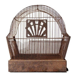 Early 1900s Antique Bird Cage - A charming 1910s bird cage with an aged, rusted metal patina. The worn wire mesh wraps around the bottom half of the cage. The crown logo door swings open on the front and latches closed against the metal bars. A small wood perch hangs from the top center bar. The base pulls out as a drawer for cleaning.