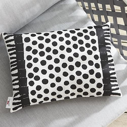 """Party Carpet 20""""x13"""" Outdoor Pillow - Joyful combinations of cheerful graphics and eclectic collages celebrate high-spirited gatherings, small and grand. Bold black outlines a playful graphic of a dotted, fringed rug on weather-resistant white polyester."""