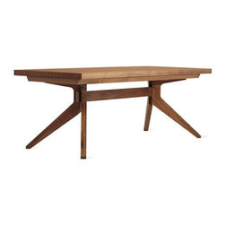 "Design Within Reach - Cross Extension Table - With spare clean lines and no decorative excess, Matthew Hilton's Cross Extension Table (2005) pairs the elegance and warmth of classic English furniture with the simple beauty of 21st-century modernism. This table has a straightforward aesthetic that will suit almost any environment. While the Cross Extension's strong, unadorned geometry creates a distinctly up-to-date piece, Hilton softens the outline with tapered legs that flare from the base like the supports of traditional pedestal tables. Adaptable to changing dining needs, the tabletop expands with a simple pull, allowing insertion of up to two leaves for three possible table sizes: 78.75"", 97.5"" and 116"". After guests depart, the leaves store in a felt-lined compartment on the table's underside. The Cross Extension Table received the 2006 Elle Decoration Best in Furniture Award. Walnut table made in Malaysia; others made in Lithuania. DWR Exclusive To see more of our top pinned items, click here."
