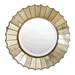 Amberlyn Mirror - A sunburst-style mirror of refined glamour that outshines the ordinary with its shimmering beauty. The Amberlyn Mirror features a round center mirror surrounded by heavily antiqued gold leaf mirrors with burnished edges; each glass panel boasts a delicately etched floret reminiscent of the handiwork of European artisans. A generously-sized bevel enhances the heirloom quality of the piece.