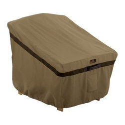 Classic Accessories Hickory Standard Chair Cover - Tan - Instead of trying to find a place to store your patio chair this winter, use the Classic Accessories Hickory Standard Chair Cover - Tan. As handsome as it is handy, this cover is made of tan Weather10 material with Weather Leather trim that looks genuine yet won't rot. Padded handles ensure easy on and off and large air vents prevent mildew and wind lofting. For a secure fit, this chair cover uses a combo of click-close straps and an adjustable elastic hem cord at the bottom. It has a waterproof, laminated liner and is designed to fit most standard patio chairs. Includes a manufacturer's limited lifetime warranty.About Classic AccessoriesFounded from small beginnings, Classic Accessories has grown in the past 30 years from a small basement operation in Seattle's Roosevelt neighborhood making seatbelt pads and steering wheel covers, to a successful and expanding company now making a wide variety of products from car to boat covers and much more. Innovative, stylish designs define products that are functional and made to last. From little details to the largest innovations, Classic Accessories is always moving forward and looking to provide cover and storage solutions to a clientele that has a passion for the outdoors, from backyard gatherings to exciting camping trips, Classic Accessories provides the products that keeps your equipment looking great all season long.