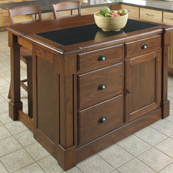 Home Styles - Aspen Kitchen Island with Granite Top - Create ambiance and the perfect balance of warmth and style with the Aspen Collection. Mahogany solids and cherry veneers are warmed with a Rustic Cherry finish. Recessed door panels, a profiled edge top, with black granite .75'' inset top and bold molding detail draw the eye deeper in. Storage function can be found in the four storage drawers and a storage cabinet with one adjustable shelf. What makes this island really unique is the hidden sliding mechanism connected to the back two posts. The mechanism provides easy mobility and independent movement of the two posts for expansion of the breakfast bar. Either with the breakfast bar closed or in use, this piece has a polished look by being consistently styled on both the approach and working sides Features: -Four storage drawers.-Storage cabinet.-Adjustable shelves.-Mahogany solids and cherry veneer construction.-Rustic cherry finish.-Aspen Collection.-Product Type: Kitchen Island.-Collection: Aspen.-Base Finish: Rustic Cherry.-Counter Finish: Granite inset.-Hardware Finish: Antique Brass.-Distressed: Yes.-Powder Coated Finish: No.-Gloss Finish: No.-Base Material: Wood.-Counter Material: Granite.-Hardware Material: Antiqued brass.-Solid Wood Construction: No.-Number of Items Included: 1.-Water Resistant or Waterproof: No.-Stain Resistant: No.-Warp Resistant: No.-Exterior Shelves: No.-Drawers Included: Yes -Number of Drawers: 4.-Push Through Drawer: No..-Cabinets Included: Yes -Number of Cabinets : 1.-Double Sided Cabinet: No.-Number of Interior Shelves: 2.-Adjustable Interior Shelves: Yes.-Number of Doors: 1.-Locking Doors: No.-Door Handle Design: Finger pulls..-Towel Rack: No.-Pot Rack: No.-Spice Rack: No.-Cutting Board: No.-Drop Leaf: Yes.-Drain Groove: No.-Trash Bin Compartment: No.-Stools Included: No.-Casters: No.-Wine Rack: No.-Stemware Rack: No.-Cart Handles: No.-Finished Back: Yes.-Commercial Use: No.-Recycled Content: No.-Eco-Friendly: No.-Product Care: