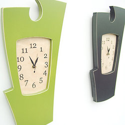 Clock No. 2 - Simon Says Wall Clock - Clock No.2 is a lively wall clock that makes a great accent for any room.  The traditional 'key-hole' profile at the top of the wall clock give the design a classic foundation while the abstracted shape adds unexpected interest.  Perfect for a perfect kitchen, bedroom or office, Clock No.2 is an excellent opportunity to bring a splash of color into a room.The clock may be ordered as shown or in any of our vibrant paint of stain colors.Features a painted or stained birch panel frame and laser engraved maple face.  The clock is given a lasting beauty by the protective coating of high quality clear coat.  Also features a durable Seiko clock movement (requires one AA battery).