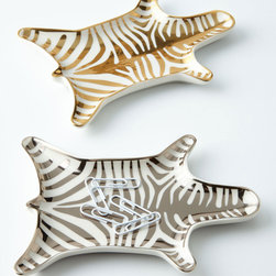"""Jonathan Adler - Zebra Dish - Jonathan AdlerZebra DishDetailsGraphic zebra dish sold individually.Made of high-fired porcelain.Sold individually; each 6""""W x 4""""D x 0.5""""T.Imported.Designer About Jonathan Adler:Potter designer and author Jonathan Adler launched his first ceramics collection in 1994. His design philosophy: create a foundation of timelessly chic furniture and accessorize with abandon. With his roots still firmly in pottery he has expanded to become a complete lifestyle brand offering furniture lighting decorative objects fashion accessories and more. He is dedicated to bringing style craft and joy to life."""