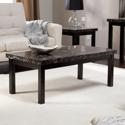 Galassia Coffee Table - The Galassia Coffee Table makes a regal centerpiece to your new living room or den collection. Featuring an alluring black faux marble top polished to mirror-like sheen, the piece is supported by a solid hardwood frame and features a dark black finish that complements the top handsomely. This contemporary style piece has an open, minimalist design that pairs well with other contemporary style or rich leather pieces. Some assembly is required.