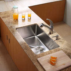 Kraus - Kraus KHU100-30-KPF2110-SD20 Single Basin Undermount Kitchen Sink with Faucet Mu - Shop for Kitchen from Hayneedle.com! Your kitchen will run smoothly thanks to the Kraus KHU100-30-KPF2110-SD20 Single Basin Undermount Kitchen Sink with Faucet and its sleek modern design. Its faucet runs smoothly with a single lever and even doubles as a strong sprayer. The whole set is made from stainless steel to take on corrosion for years to come.Product SpecificationsBowl Depth (inches): 10Weight (pounds): 32Low Lead Compliant: YesEco Friendly: YesMade in the USA: YesHandle Style: LeverValve Type: Ceramic DiscFlow Rate (GPM): 2.2Spout Height (inches): 7.5Spout Reach (inches): 8.5About KrausWhen you shop Kraus you'll find a unique selection of designer pieces including vessel sinks and faucet combinations. Kraus incorporates its distinguished style with superior functionality and affordability while maintaining highest standards of quality in its vast product line. The designers at Kraus are continuously researching and exploring broader markets seeking new trends and styles. Additionally durability and reliability are vital components at Kraus for developing high-quality fixtures. Every model undergoes rigorous testing and inspection prior to distribution with customer satisfaction in mind. Step into the Kraus world of plumbing perfection. With supreme quality and unique designs you will reinvent how you see your bathroom decor. Let your imagination become reality!