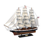 Handcrafted Nautical Decor - Flying Cloud 30'' - SOLD FULLY ASSEMBLED--Ready for Immediate Display - Not a Model Ship kit --This fine tall ship model of the famous clipper ship Flying Cloud  is perfectly sized for any shelf, desk, or mantle. Renowned for her  speed and endurance sailing the open seas, these proud tall ship models  of the Flying Cloud add a touch of historic spirit and flair of nautical Decor to any bedroom, den, or office. ----------    Arrives fully      assembled with      all sails mounted--    Handcrafted wooden hull and masts--    Historically      accurate sail      configuration and extensive rigging--    2 anchors with metal chain attached--    21 handsewn white cloth sails--    --    Metal nameplate on wooden base identifies the ship as the Flying Cloud--