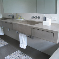 """Concrete Bathrooms - 6"""" thick concrete vanity with integral sinks and integral drawers all concrete.  Matching concrete tub surround."""