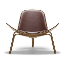 ch07 lounge | HiveModern - Hans Wegner produced this chair in 1963 and surprisingly, the three-legged number was not exactly a smashing success. Luckily it was given a second chance in the 1990s and now super chic architects and interior designers snap them up as fast as they can.