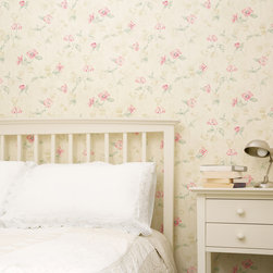 Meadowlark - Modern country elegance with cream furniture and a pretty floral wallpaper.