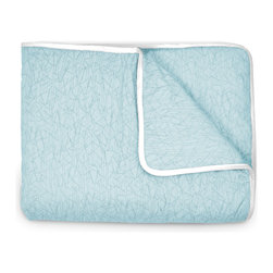 OLLI+LIME - TWIG CRIB QUILT - POOL - Soft cotton crib quilt in nature-inspired pool Twig design. Contrasting piping and logo detail. Polyfill insert.