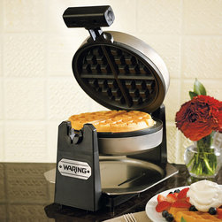 "Frontgate - Waring Pro Waffle Maker - Square - Bakes extra-deep, 1"" thick waffles. Brushed stainless steel housing. Easy-to-handle rotary feature evenly bakes and browns. Shade control allows you to select your preferred browning level. Blue LED light and beeping sound indicate when waffles are ready to eat. The waffle trend is heating up in restaurants across the country, but you can enjoy gourmet quality waffles made fresh at home, without the wait. Whether you prefer classic golden Belgium or more savory renditions, the easy-to-use Waring Pro Waffle Maker bakes extra-deep, fluffy cakes, golden to perfection. Simply preheat, pour in the batter, and enjoy hot waffles in less than 3 minutes.  .  .  .  .  . Includes an exact-measure pouring cup . 3-prong grounded plug . One year limited warranty . 24"" cord; 120V ."