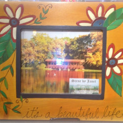 "Sarah Grant / Sticks Furniture - Sticks Photo Frame 8x10 for Wall or Desk - This hand carved and hand painted picture frame with 3"" border holds an 8"" x 10"" horizontal photo and features the phrase ""It's a Beautiful Life"" along the bottom. The main background area is painted with a subdued golden color. The charming wild flowers are layered with cream, red, blue, and purple and stand out with green leaves and tendrils."