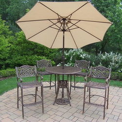 Oakland Living - 7-Pc Outdoor Bar Set - Includes a bar table, four bar stools, 108 in. tilt crank umbrella with stand and metal hardware. Traditional lattice pattern and scroll work. Handcasted and lightweight. Durable and rust free. Fade, chip and crack resistant. Hardened powder coat. Warranty: One year. Made from cast aluminum. Antique bronze finish. Minimal assembly required. Table: 42 in. Dia. x 44 in. H (60 lbs.). Bar stool: 21.5 in. W x 22 in. D x 46 in. H (47 lbs.)The Oakland Mississippi Collection combines grace style and modern designs giving you a rich addition to any outdoor setting. The pattern is crisp and stylish. Each piece is finished for the highest quality possible. This set will be a beautiful addition to your patio, balcony or outdoor entertainment area. Our bar sets are perfect for any small space, or to accent a larger space. We recommend that the products be covered to protect them when not in use. To preserve the beauty and finish of the metal products, we recommend applying an epoxy clear coat once a year. However, because of the nature of iron it will eventually rust when exposed to the elements.