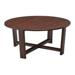 Greenington - Daisy Round Coffee Table - X marks the spot: This coffee table will round out and well serve your living room with its pleasing circular shape, rich bamboo material, and sleek modern design.