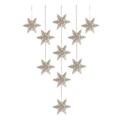 Ornaments, Snowflakes, Set of 10 - A sparkly snowflake looped into the bow of a wrapped gift not only looks so lovely, the recipient can then add it to their collection of ornaments.