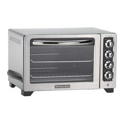 "KitchenAid Convection Toaster Oven - Able to accommodate two 12"" pizzas or a four-pound chicken, this stylish stainless time- and space-saver offers full-size oven performance for the countertop with consistent, even heating to 450 degrees, broiling and convection baking. Features include a 60-minute timer, warm function for holding or reheating, full-width crumb tray, broil and drip pans."