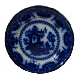 "Flow Blue Dish - Here's a pretty flow blue dish that measures 7 1/2"" in diameter.  Flow blue was produced between 1826 and 1926, mostly in England, and was aptly named because the pattern was made to ""flow"" onto undecorated blanks.  This has an Asian motif of a water bearer headed for a well.  The back is stamped ""Oregon Chinese Porcelaine T J & J Mayer, Longport and has what appears to be the symbol of a griffin.  It is chipped on the bottom rim of the plate and is undetectable until one turns it over.  It's not easy to purchase full sets of this type of porcelain any longer, but one can still use them as accent pieces for holiday presentations and they make a bold statement when hung in groups on a wall."