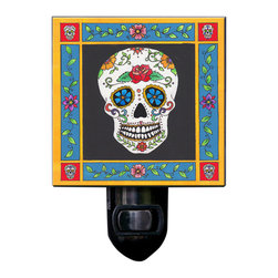 Day of the Dead Night Light - Our Day of the Dead Sugar Skull Night Light is made of a print of original painting, which is sandwiched in between two layers of durable acrylic. The light is UL approved and comes with a standard four watt night light bulb. Gift box included. Made in the USA. (Be sure to look for our butterfly wall clock, alarm clock and magnets, too!)